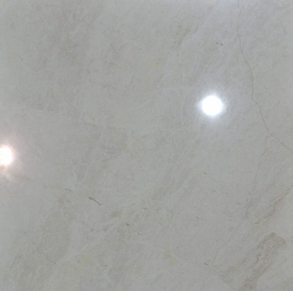 24x 24 Queen White is a light cream color natural marble that we store in our warehouse to sell to our retail customers in our Tile Store in Pompano Beach