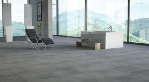 Large format porcelain tile in dark grey color for industrial style, contemporary interiors.