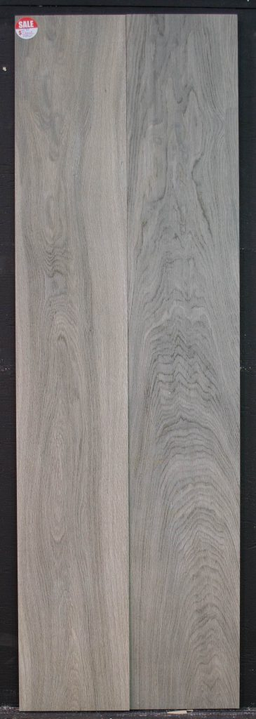 Wood Look Tile Guaya Grey : 8 x 48 rectified porcelain tile made in Spain that comes in bluish grey wood grains over a grey background color.