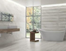 Large format polished porcelain tile in light grey color with marble look