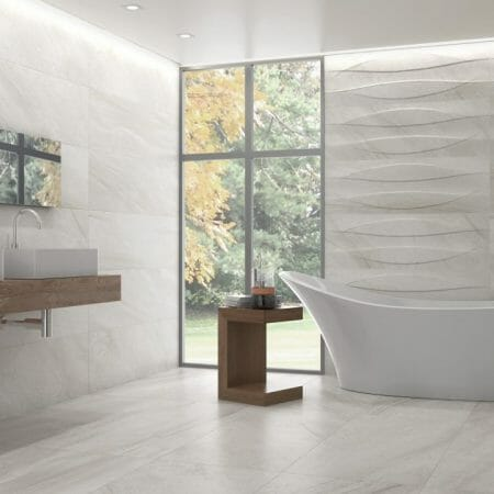 Large format polished porcelain tile in light grey color with marble look