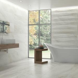 large format porcelain tile in light grey color with limestone effect
