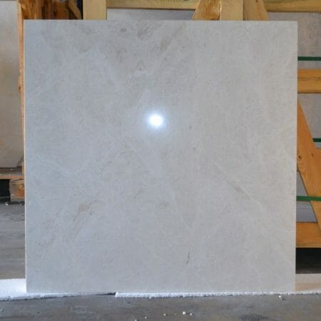 Large format marble in light cream color.