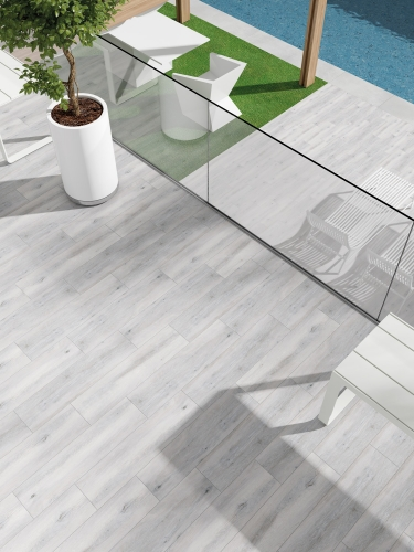 Light background wood look tile with grey veining Forever Tilo From Spain