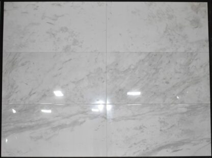 """The picture above is 24"""" x 48"""" White marble effect porcelain floor and wall tile Carrara Aura. This tile has heavy light grey color veining on a white background color"""