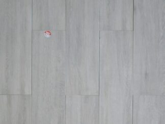 Montana Ash is a rectified porcelain tile from Spain with Wood Look on a grey background