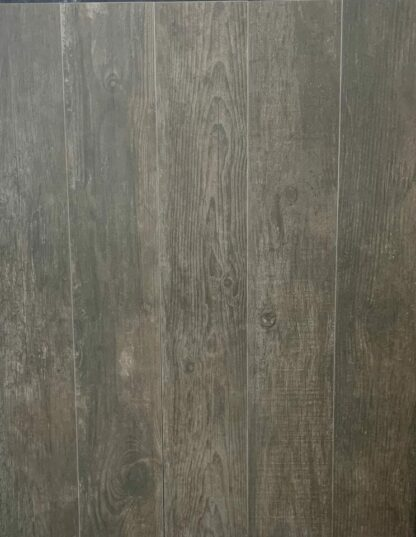 Wood look porcelain tile grove shadow is a porcelain tile with dark hardwood floor effect. Made in Spain.