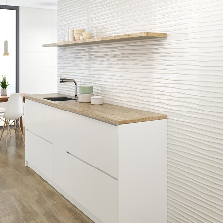 Palin white wall tile with 3D waves that are called wellen