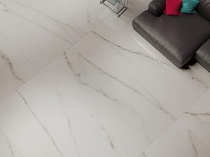 Porcelain tile with marble look with creamy white background and grey veins.
