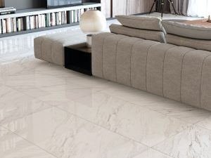 closeup picture of porcelain floor tile with white background and soft grey veining that looks like dolomite installed on living room