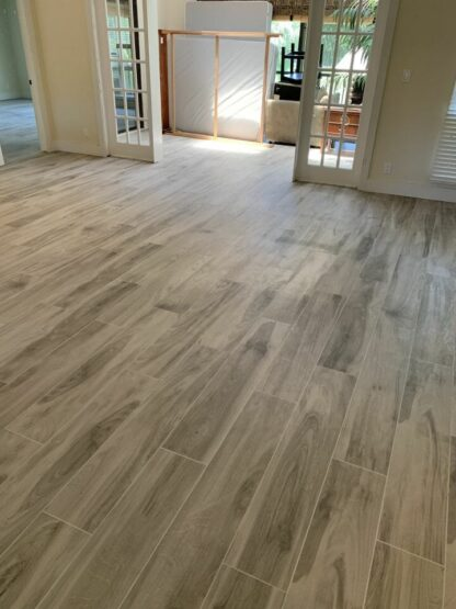 main floor picture showing Bellver Grey wood look porcelain tile installed