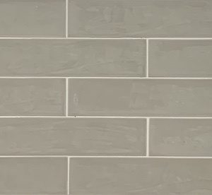 Light Grey Subway tile with light reflecting surface.