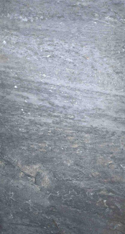 detailed product picture of dark grey porcelain tile mimicking natural rocks