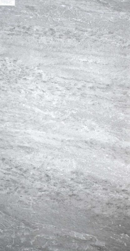 detailed product picture of 24x48 grey porcelain tile that looks like rock