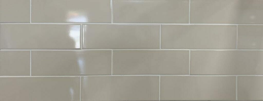 Light beige color subway tile with glossy finish in 4x12 size