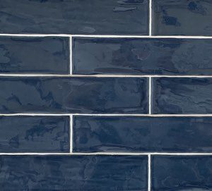 Blue color subway tile in maiolica style from Spain