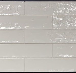 White Subway Tile With Prints On It