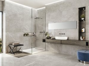Large Format porcelain tile with the look of a limestone in grey color and some random white veins