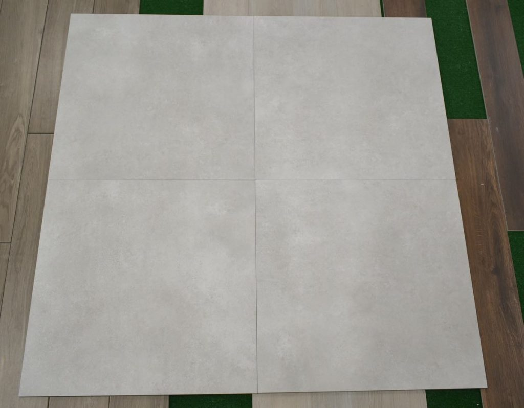 32x32 tile with the look of concrete floors in white color with some grey