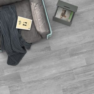 Palio Grey is a modern style wood grain porcelain tile that brings industrial cement floors elements on a wood look