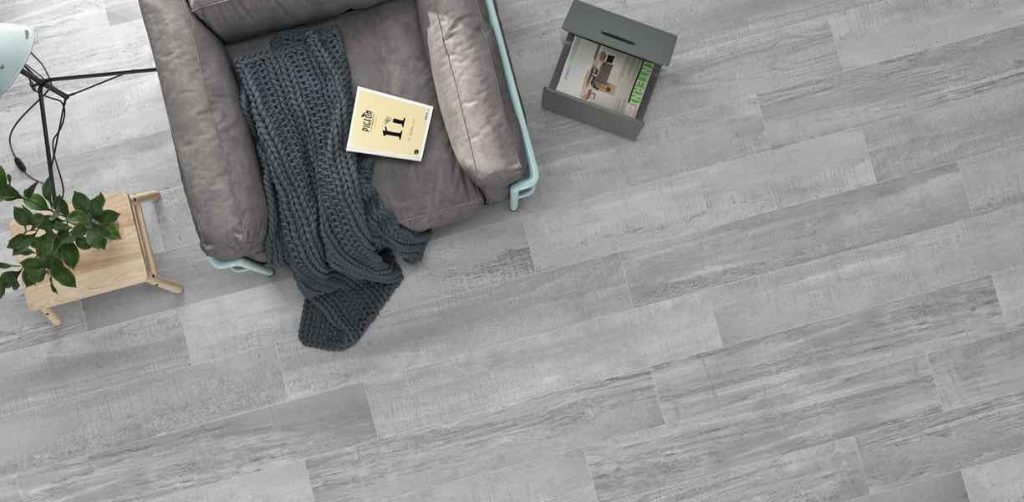Palio Grey is a modern style tile that comes with wood texture to mimic hardwood floors. This tile has a modern design in grey color that brings industrial cement floors elements onto hardwood floor.