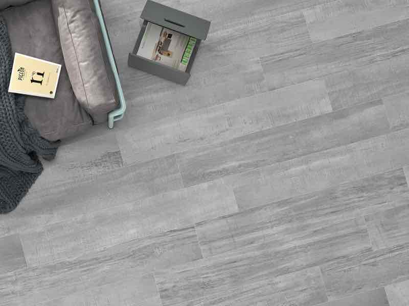 palio grey is a wood look porcelain tile adding concrete elements to the wood style