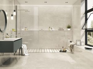 porcelain tile in the 24x48 size in ivory color with silver background with the look of the limestone