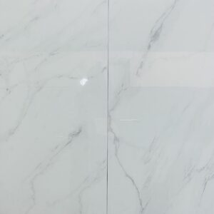 24x48 Status White Porcelain has the look of white Carrara Marble with soft gray veining over a white background