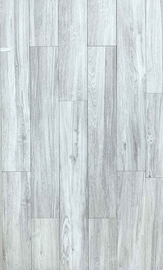 Porcelain floor tile with grey wood grains on a white background in the whitewash style