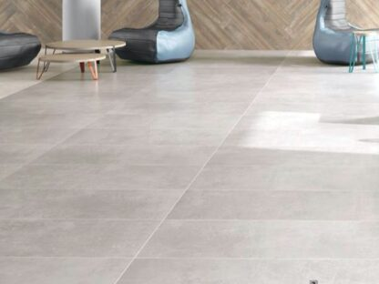 product image studio light grey porcelain tile that looks like industrial concrete floors in light grey color