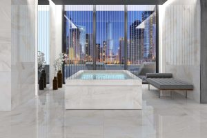 a building entrance with onyx look porcelain tile on the walls and floors