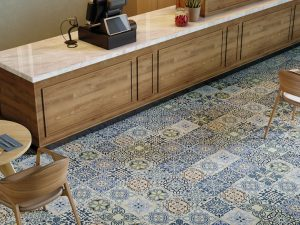 decorative blue tile in Moroccan Style with floral design in geometric shape.