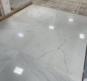 showroom floors with warm white marble look tile Santorini