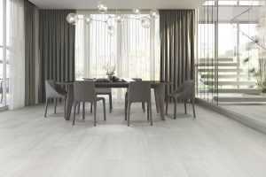 light gray color wood look tile in dining room