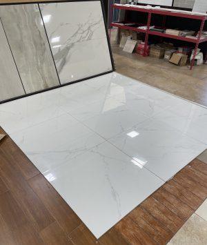 white porcelain tile with soft grey veining for floors.