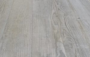 close up picture of Porcelain tile that looks like old wood, whitewashed wood