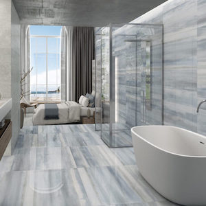 light blue color tile with a linear design on bathroom floors and walls.