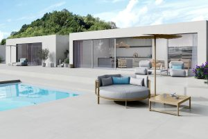 pool deck scene light color porcelain tile with look of cement look in a minimalistic style concrete look