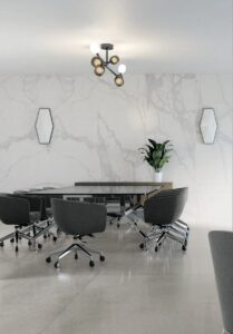 Accent wall with Kalos Porcelain Slab that looks like a white marble with light gray veining