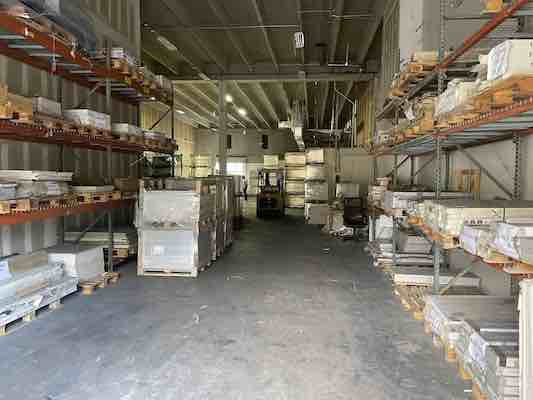 PICTURE OF TILES & STONE WAREHOUSE FULL OF FLOOR AND WALL TILES IN STOCK